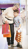 Grandmother and grandson with paperbags — Stock Photo