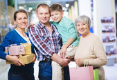 Family after shopping — Stock Photo