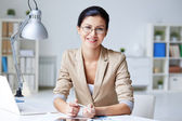 Businesswoman at workplace — Stock Photo