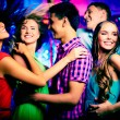 Dancing at disco — Stock Photo