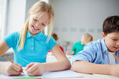 Cute schoolkids at lesson — Stock Photo
