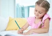Girl with crayon — Stock Photo