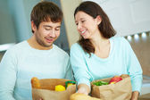 Couple with packets — Stock Photo