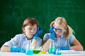 Children at chemistry lesson — Stock Photo