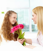 Giving tulips to mother — Stock Photo