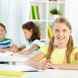 Schoolchild at desk — Stock Photo