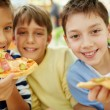 Boys enjoying pizza — Stock Photo #42525429