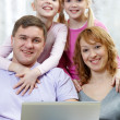 Family with laptop — Stock Photo #42525895