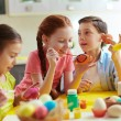 Kids painting Easter eggs — Stock Photo #42526347