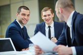 Businessmen interacting — Stock Photo