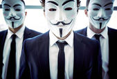 Business team covered with masks — Stock Photo