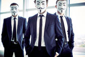 Anonymous men Portrait of three masked guys — Stock Photo