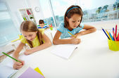 Girls drawing — Stock Photo