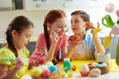 Kids painting Easter eggs — Stock Photo