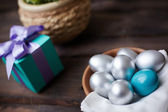 Eggs and gift — Stock Photo