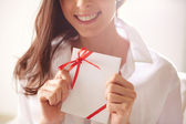 Female holding valentine letter — Stock Photo