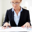 Businesswoman working with papers — Stock Photo