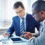Businessmen discussing data — Stock Photo #46268511