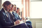 Empresários no seminário — Fotografia Stock