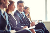 Business people at seminar — Stock Photo