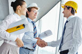 Architects striking a deal — Stock Photo
