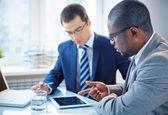 Businessmen discussing data — Stock Photo