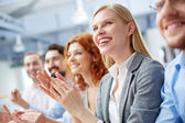 Businesswoman applauding — Stock Photo