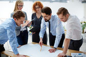 Engineers discussing blueprint — Stock Photo