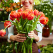 Florist with tulips — Stock Photo #46275617