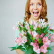 Ecstatic woman with flowers — Stock Photo #46276959