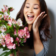 Ecstatic woman with flowers — Stock Photo #46277259
