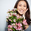 Satisfied woman with flowers — Stock Photo #46277271