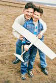 Father and son with toy airplane — Stock Photo