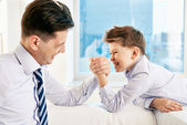Boy and his dad armwrestling — Foto de Stock