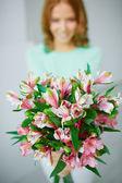 Lilies held by female — Zdjęcie stockowe