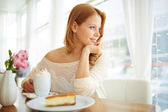 Serene girl sitting in cafe — Stock Photo