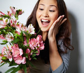 Ecstatic woman with flowers — Stockfoto