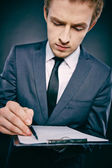 Businessman making notes — Stock Photo