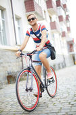 Guy riding bicycle — Stock Photo