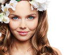 Model with hair decorated with flowers — Stock Photo