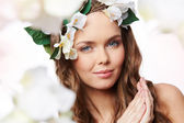 Woman with hair decorated with flowers — Stock Photo