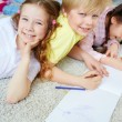 Girls and boy drawing — Stock Photo