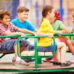 Friends having fun on carousel — Stock Photo #46322193