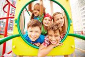 Friends having fun on playground — Stock Photo