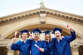 Joyful graduates — Stock Photo