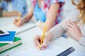 Groupmates carrying out written task — Stock Photo