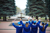 Backs of graduates — Stock Photo