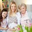 Family with giftboxes — Stockfoto