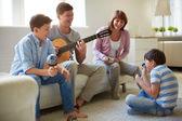 Family of four having fun — Stock Photo