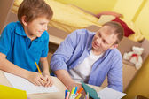 Father  with son doing schoolwork — Stock Photo